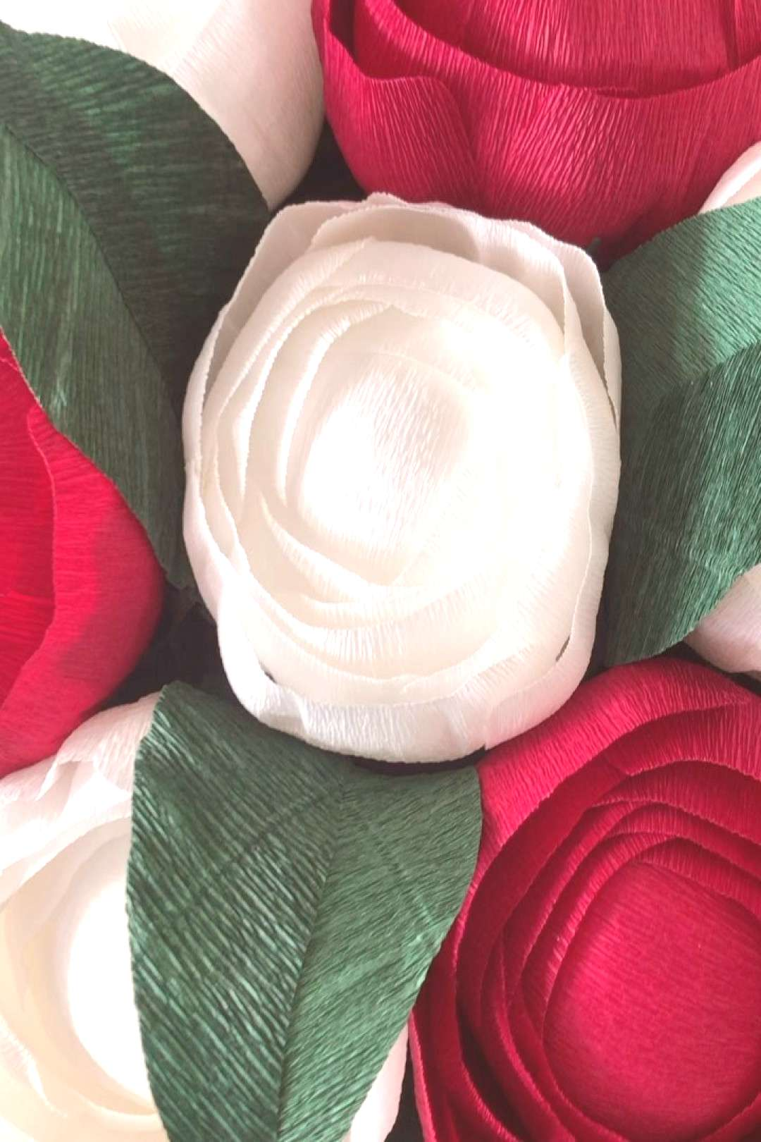 A red and white combination today of our handmade ranunculus flow