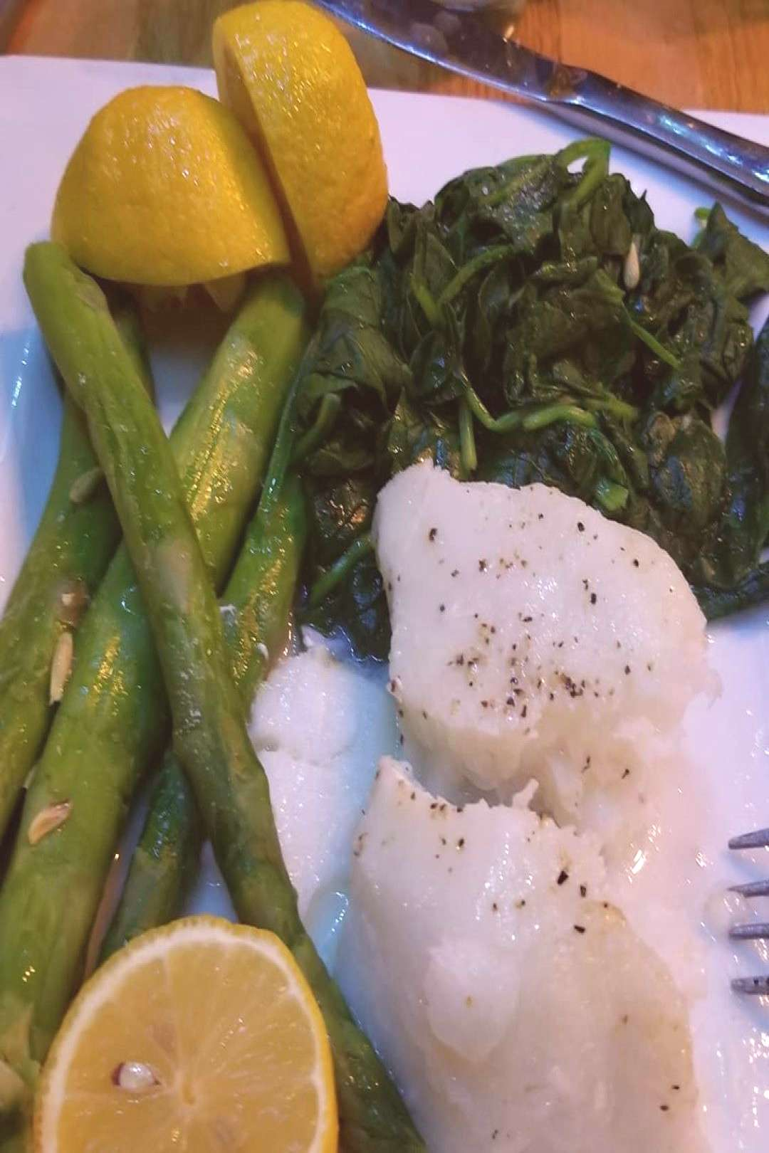 Dinner out.... Chilean sea bass, asparagus amp spinach. I asked the
