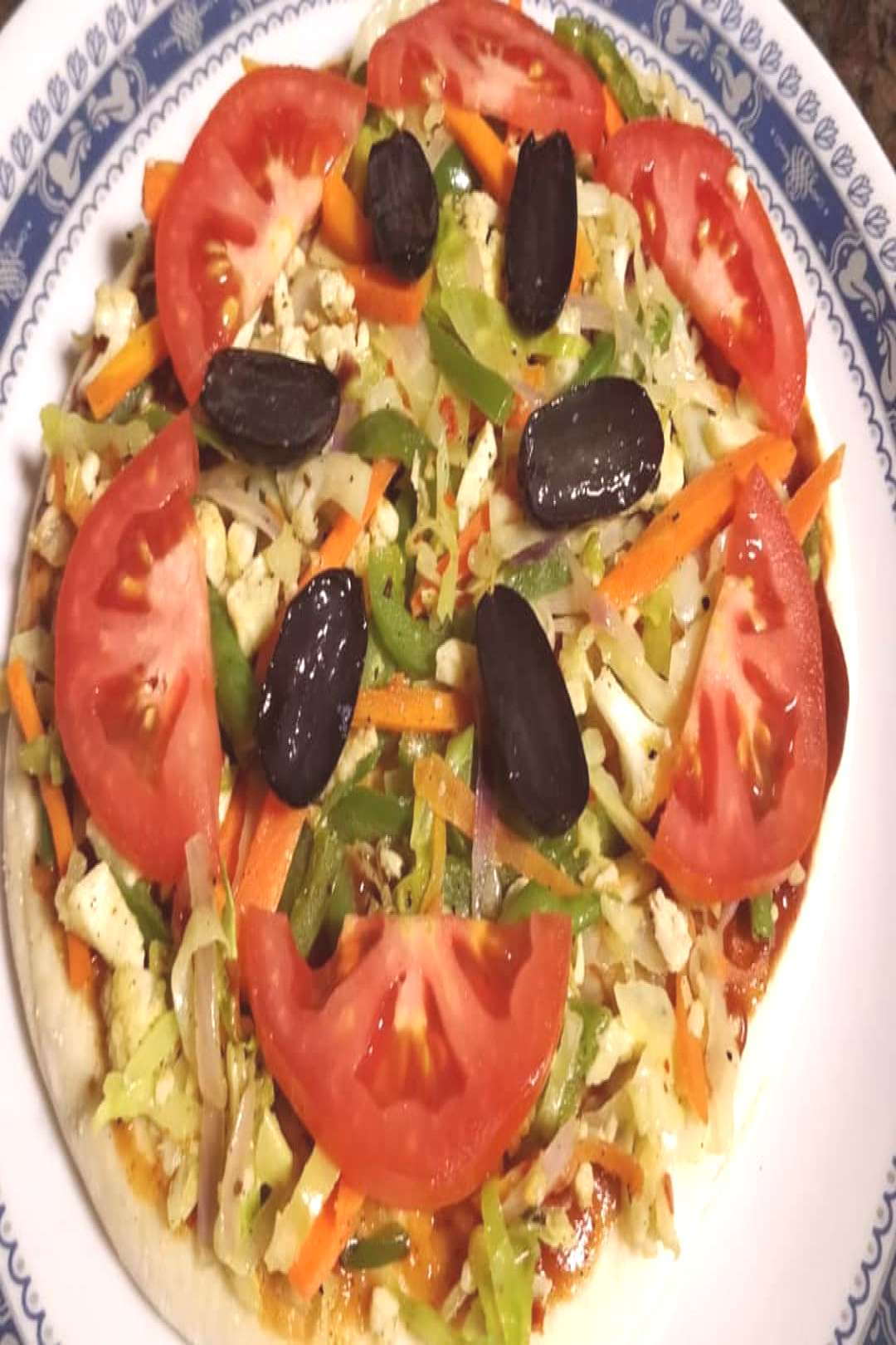 Healthy home made pizza topped with 4CPTs (cauliflower, carrots,