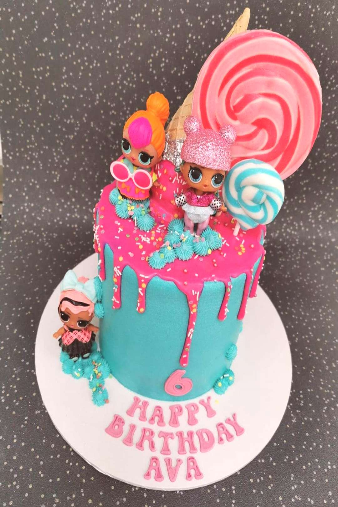 LOL themed birthday cake, with a bright pink drip decorated with
