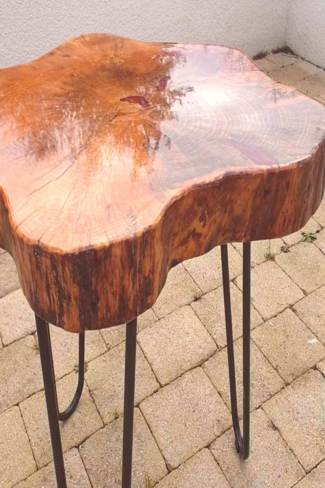 Raw wood, natural colours finished with a red mist twist. Glass l